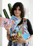 Fella Matougui with some of her manga