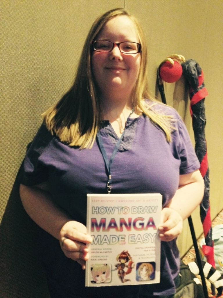 Emily with her copy of How To Draw Manga Made Easy
